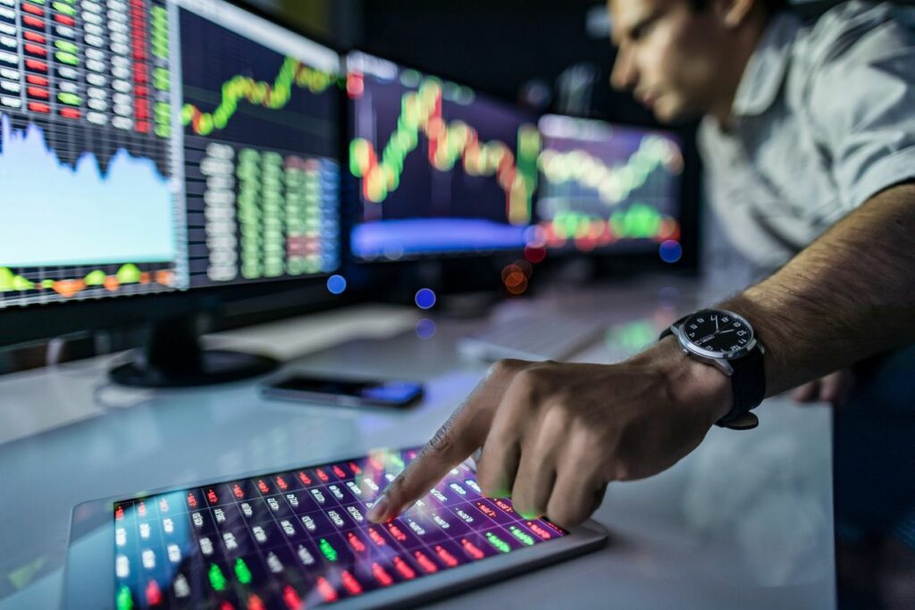 man looking at stock market numbers